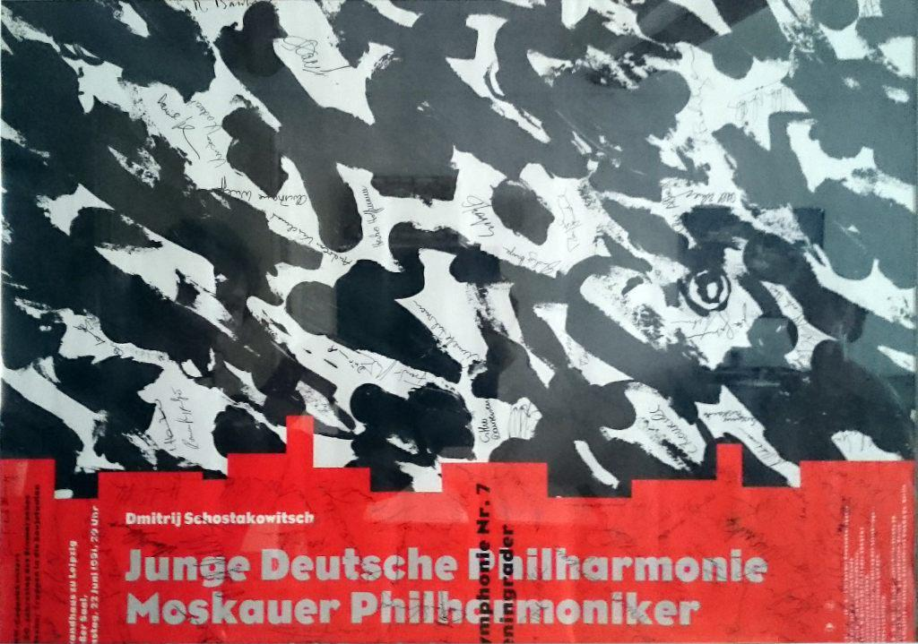 Poster of the concert of the Junge Deutsche   Philharmonie. Signatures of all musicians of the   Orchestra are on the poster.